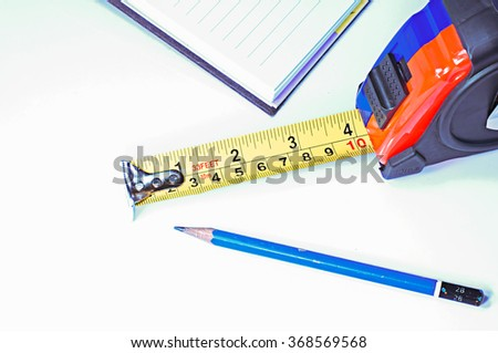 Measuring tape combined with office equipment.