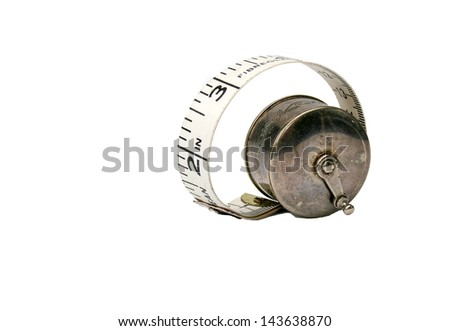 Measuring tape in antique silver holder - stock photo