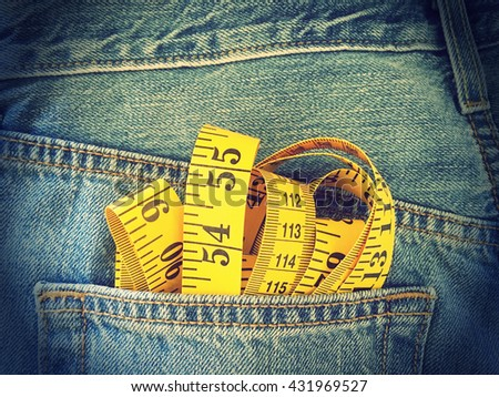 measuring tape in the pocket of blue denim jeans retro style