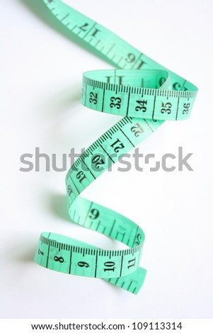 Measuring tape of the tailor isolated on white background - stock photo