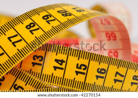 Measuring tape of the tailor. Shallow DOF. Close-up. - stock photo