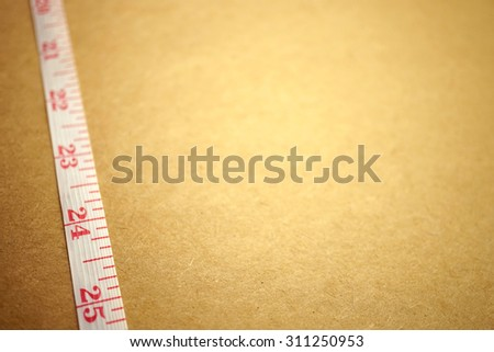 Measuring tape on craft paper for background (diet concept)