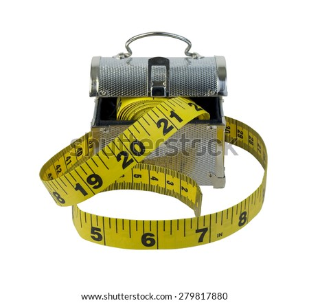 Measuring tape with ticks and numbers to measure items with a metal lunch box - path included - stock photo