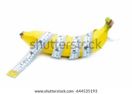 Measuring tape wrapped around a banana, isolated on a white background