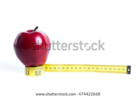 Measuring tape wrapped around a green apple .Concept symbol of diet
