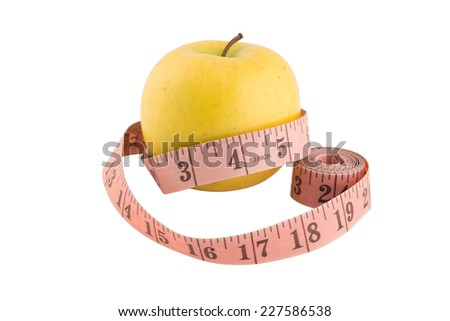 Measuring tape wrapped around a yellow apple. Isolated over white. Path included - stock photo