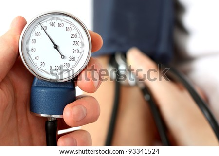 Measuring the blood pressure - stock photo