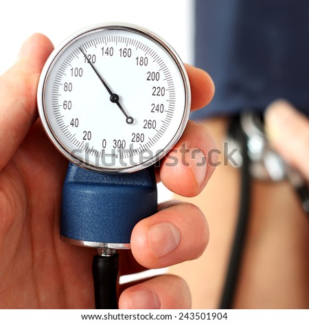 Measuring the normal blood pressure - stock photo