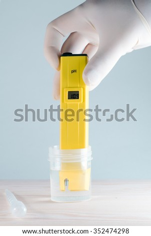 Measuring the pH of the water. Electronic pH meter - stock photo