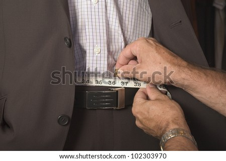Measuring the waist - stock photo