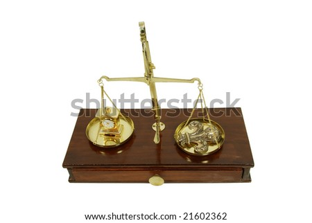 Measuring time passing with a clock, Brass and wood Scale used to weigh out small items, Fleur de lis - stock photo