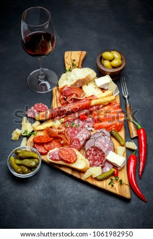 meat and cheese plate and wine with sausage prosciutto olives & Meat Cheese Plate Wine Sausage Prosciutto Stock Photo (Safe to Use ...