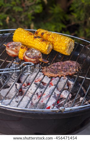 meat and corn on the grill
