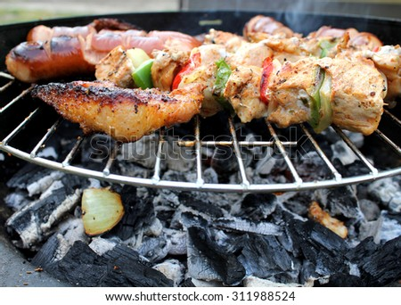 Meat and vegetables char-grilled   - stock photo