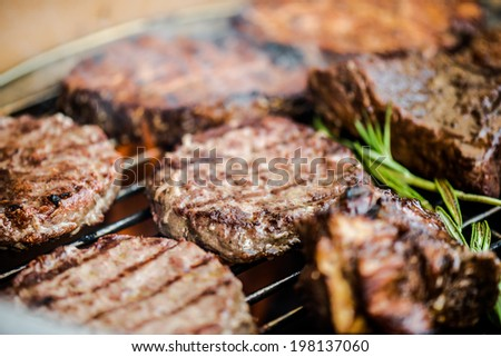 Meat and vegetables char-grilled over flame - stock photo