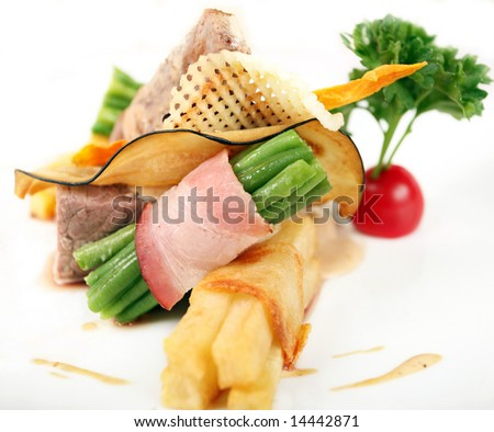 Meat and Vegetables on white (Restaurant dish)