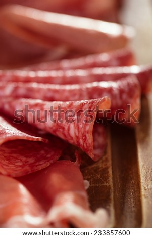 meat antipasti Platter of Cured Meat,   jamon, olives, sausage, salami  on old wooden board - stock photo