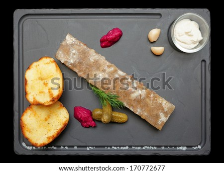 Meat aspic with baked potatoes and horseradish isolated on black, clipping path