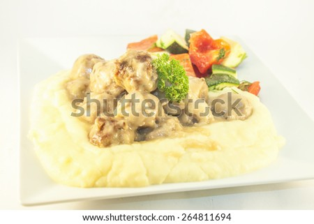 Meat balls, mashed potato and fried vegetables