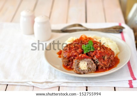 Meat balls stuffed with cheese in tomato sauce, copy space for your text - stock photo