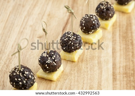 Meat balls with sesame and pineapple for party finger food.