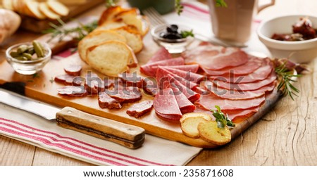 Meat board. Cured meat. Charcuterie. - stock photo