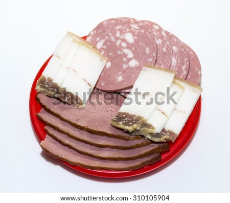 Meat, boiled sausage and salted pork fat in Ukrainian - stock photo