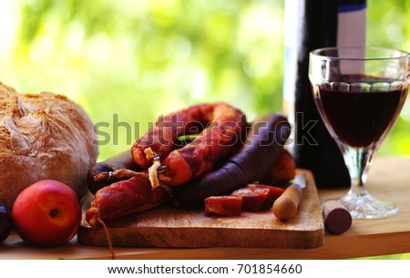 Meat, bread and red wine, traditional food of alentejo region, Portugal