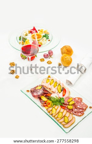 Meat Canapes, starters on White Dish - stock photo