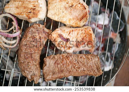 Meat char-grilled over flame - stock photo