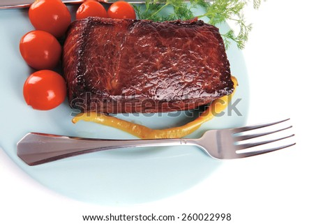 meat chunk on blue dish with knife and fork - stock photo