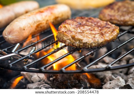Meat cooking on a barbecue BBQ grill