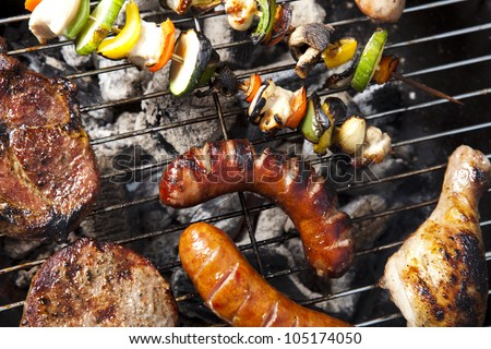 Meat cooking on barbeque - stock photo