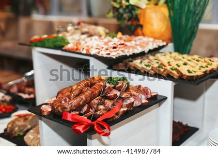 Meat courses threaded for a wedding table - stock photo