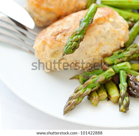 meat dish :chicken cutlet with asparagus - stock photo
