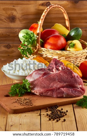 Meat dish for men, stuffed with pepper, rice with meat and spices, vegetables on the table, tasty food - energy throughout the day.