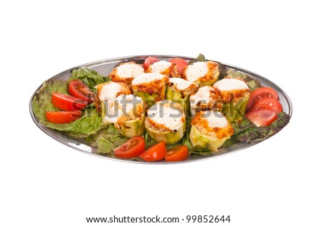 Meat dish on a plate with greens. Studio photography