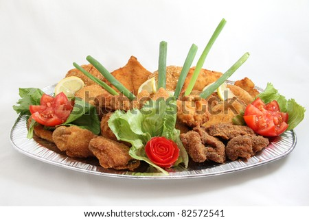 meat dish on white plate isolated on white background - stock photo