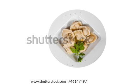 Meat dumplings - russian pelmeni, ravioli with meat. with copy space. top view. isolated on white