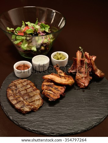 meat feed, poultry, lamb, beef steak with different sauces and salad - stock photo