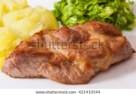 meat fillet steak with mashed potatoes and vegetables salad in a plate - stock photo