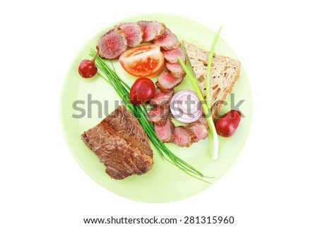 meat food : bbq meat served on green plate with tomatoes and sprouts isolated on white background - stock photo
