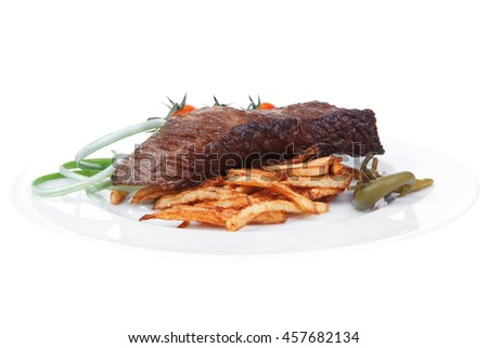 meat food : grill beef on potato chips with fresh tomato and hot green peppers isolated on white background - stock photo
