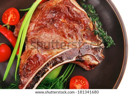 meat food : grilled beef spare rib on dark dish with thyme pepper and tomato isolated over white background - stock photo