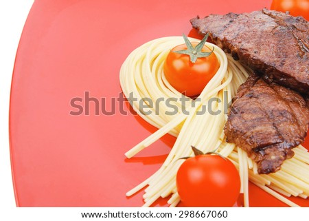 meat grilled beef steak with pasta and tomatoes on red plate isolated over white background - stock photo