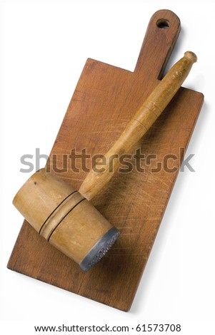 meat hammer on a cutting board with clipping path
