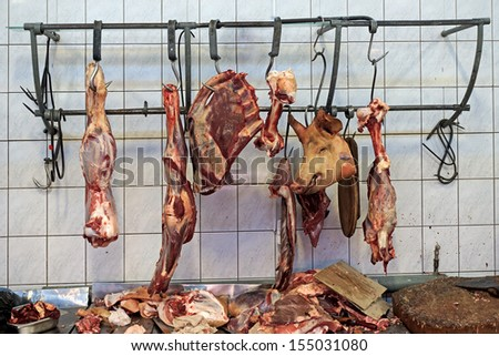 Meat hulks in butcher shop - stock photo