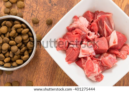 Meat in a bowl as opposite of dry dog'd food  - stock photo