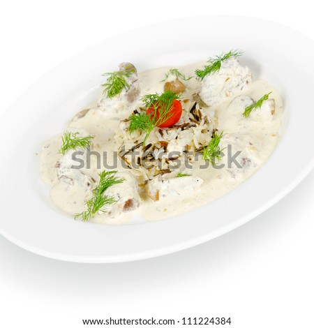 meat in a creamy sauce with mushrooms