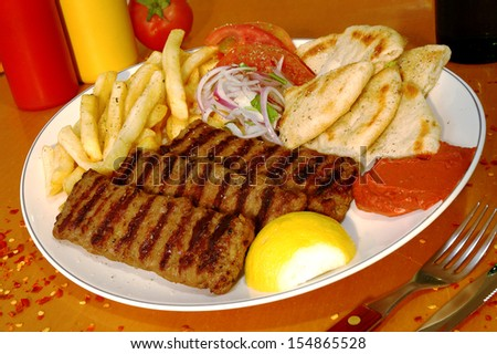 meat in plate in tavern - stock photo